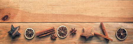 Christmas wooden panoramic background with spices, orange, cinnamon, stars
