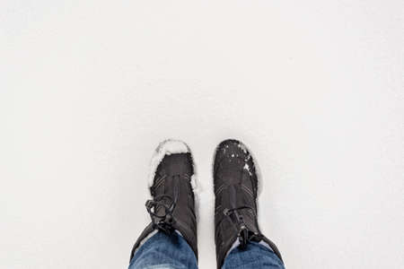 Selfie of boots in the snow, winter concept