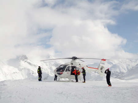 Rescue operation with helicopter on a ski slope in the ski resort of Tignes, the Alps, France