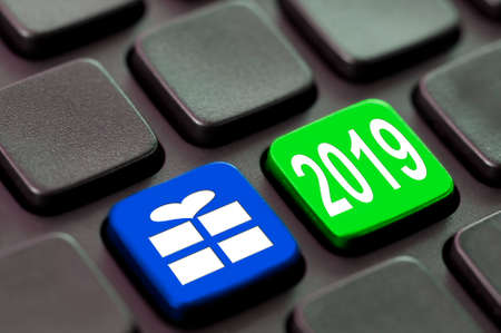 2019 and a gift icon written on a computer keyboard