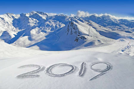 2019 written in the snow, mountain landscape in the background