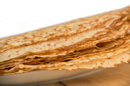 Close up on a stack of crepes (french pancakes) on a plate, white background Stock Photo