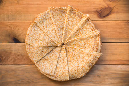 Top view of crepes (french pancakes) folded in circle, on rustic wood background