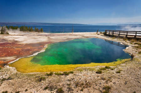 Colorful hot spring, Lake Yellowstone in the background, Yellowstone national park