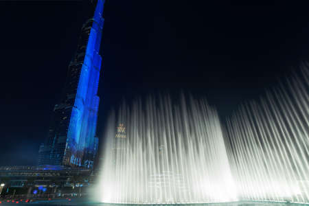 Burj Khalifa tower and the fountain show in Dubai at night, United Arab Emirates