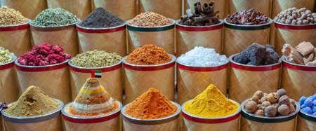 Colorful piles of spices in Dubai souks, United Arab Emirates Stock Photo