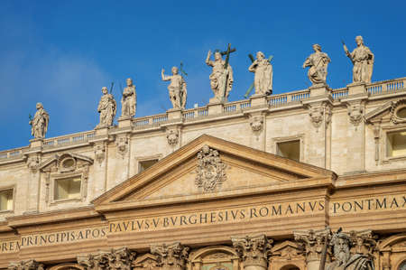 Detail of the facade of St Peters basilica in Vatican, Rome, Italy
