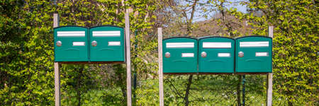 Range of mailboxes in the countryside, housing concept