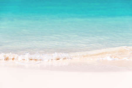 Waves on white sand and turquoise water; summer background Stock Photo
