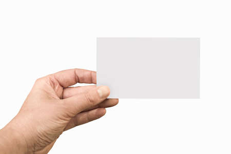 Hand holding a blank note or business card isolated on white background