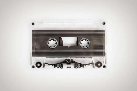 Translucent audio cassette tape on white background