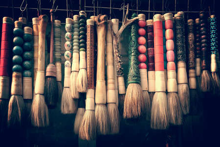 Collection of calligraphy chinese brushes at the antique market in Shanghai, China