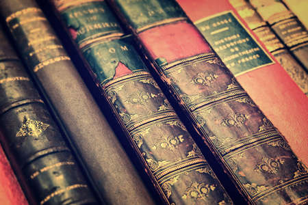 Close up of antique leather books, vintage style background