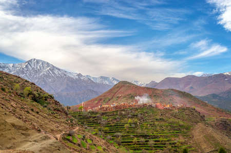 High Atlas range landscape, village of Tizi N'Oucheg and Jebel Yagour in the background, Morocco