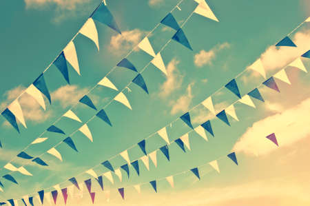 Festive blue and white garlands, vintage summer party sky background Stock Photo