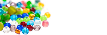 Close up on colorful translucent beads isolated on panoramic white background