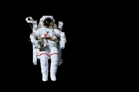 Astronaut with a jetpack isolated on black background with copy space