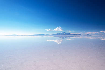 Miror effect and reflection of mountain in Salar de Uyuni (Uyuni salt flats), Potosi, Bolivia, South America Stok Fotoğraf