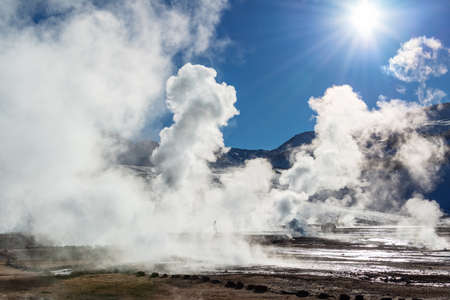 El Tatio geysers in Chile, Silhouette of a man walking among the steams and fumaroles at sunrise