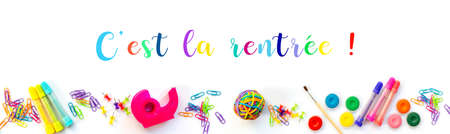 Panorama of colorful school supplies  on white background with with text cest la rentree meaning Back to School in French