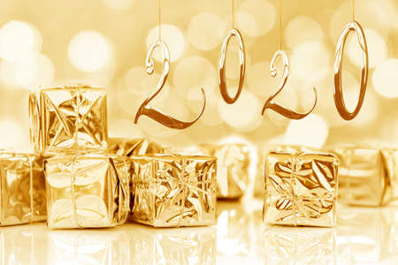 2020, new year card, small Christmas gifts in shiny golden paper, bokeh lights background Stok Fotoğraf