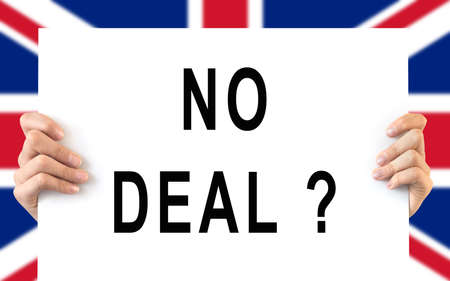 Hands holding a board No Deal, UK flag background, brexit concept