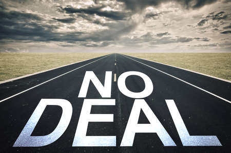 No Deal written on a road dark clouds, brexit and crisis concept