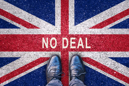 Brexit concept, no deal on a flag of the United Kingdom on asphalt road with legs Stockfoto