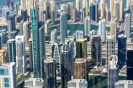 Aerial view of Dubai Marina skyline, close up on buildings from above, United Arab Emirates