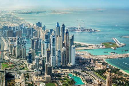 Aerial view of Dubai Marina skyline with Dubai Eye ferris wheel, United Arab Emirates Imagens
