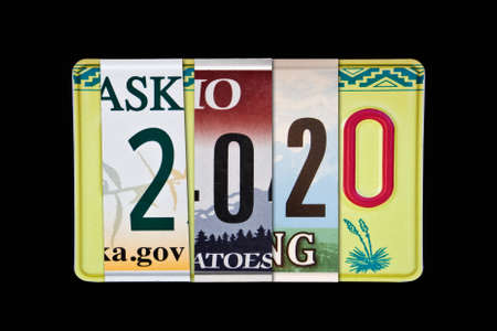 2020 writtten with US licence plates, black background