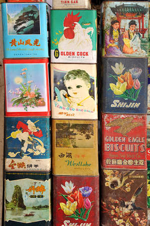 Collection of old metallic vintage biscuits tin boxes for sale at the antique market, Shanghai, China Editorial
