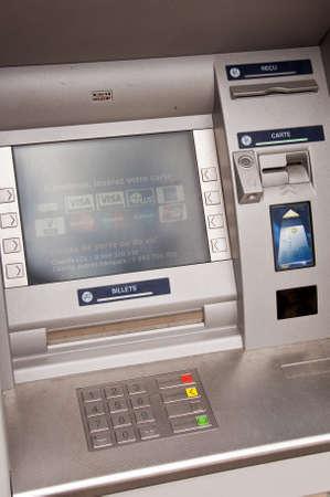 Close up of a French ATM cash dispenser machine Фото со стока