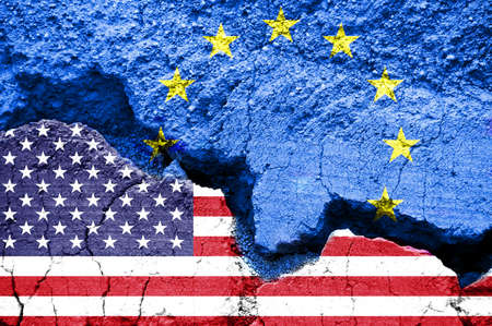 American and european flags on cracked background. Concept of crisis and commercial war between United States and Europe