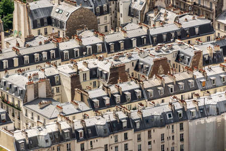 Aerial view of haussmanian buildings, traditional zinc roofs and chimneys in Paris, France 写真素材