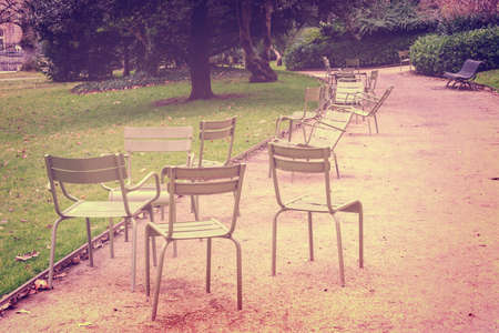 Empty metallic chairs in the Jardin du Luxembourg (Luxembourg gardens) in Paris, France Banco de Imagens