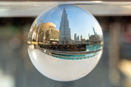Burj Khalifa tower in Dubai through a crystal ball, United Arab Emirates
