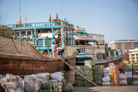 Wooden dhow cargo boats loaded with merchandise on Dubai Creek, United Arab Emirates