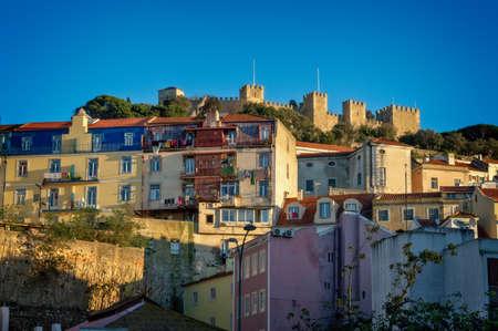 Castelo hilltop neighborhood and the medieval São Jorge Castle in Lisbon, Portugal Banco de Imagens