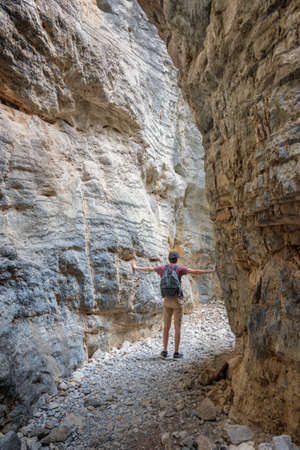 Hiker in a narrow trail of Imbros gorge, Crete, Greece