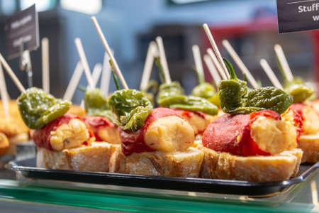 Traditional tapas and pinchos on a counter in a bar in Spain Banco de Imagens