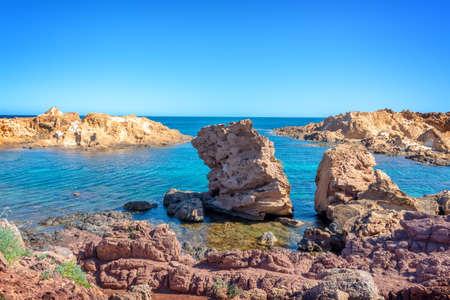Rocks in the water on the coast of Menorca, Balearic islands, Spain Banco de Imagens