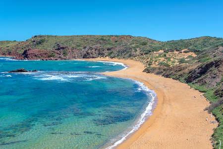 View of Cala Cavalleria beach in Menorca, Balearic islands, Spain