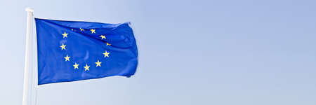 European flag in the wind on panoramic sky background Banco de Imagens