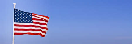 American flag in the wind on panoramic sky background Banco de Imagens