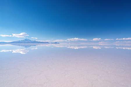 Miror effect and reflection of mountain in Salar de Uyuni (Uyuni salt flats), Potosi, Bolivia, South America