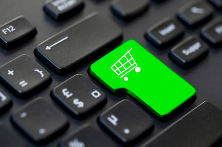 Shopping cart icon on a computer keyboard, online shopping and delivery concept