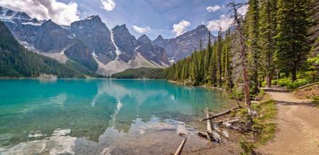 Moraine lake shoreline trail near Lake Louise village in Banff National Park, Alberta, Rocky Mountains, Canada Stock Photo