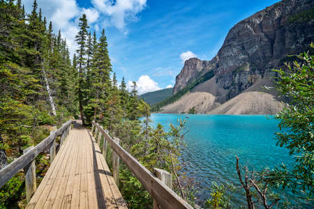 Moraine lake shoreline trail near Lake Louise village in Banff National Park, Alberta, Rocky Mountains, Canada Editorial