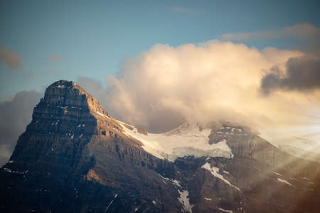 Mount Outram at sunset, view from Icefields Parkway in Banff National Park, Alberta, Rocky Mountains, Canada Stock Photo